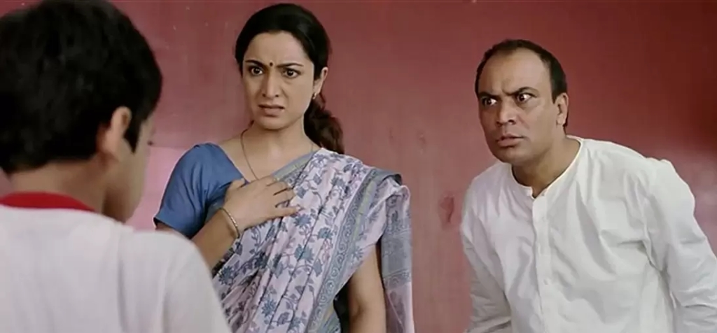 Indian mother looking outraged and dad looking like he wants to beat you